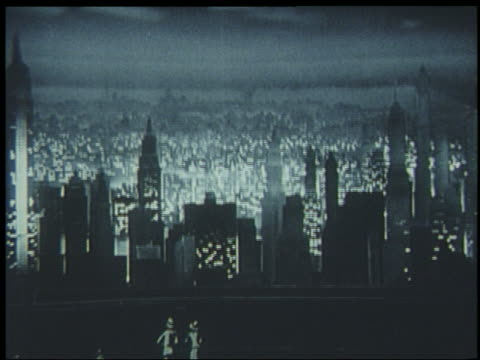 b/w 1939 miniature city skyline at night / lights turn on / world's fair - getönt stock-videos und b-roll-filmmaterial