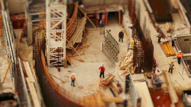 vídeos y material grabado en eventos de stock de miniature construction site from above. crane flipping over formwork panel. time-lapse tilt-shift toy look - tilt shift