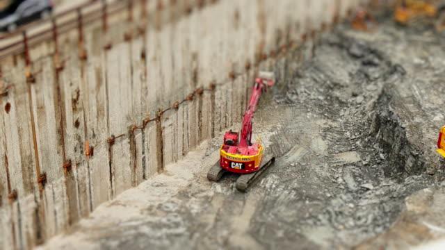 vídeos y material grabado en eventos de stock de miniature excavator on construction site. time-lapse tilt shift toy look. - tilt shift