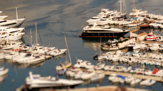 miniature luxury yacht arriving in the monaco harbour. tilt shift time lapse shot of  port hercules in monaco at daytime. - exclusive stock videos & royalty-free footage