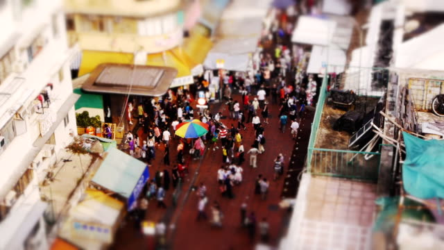 miniature tilt shift effect busy street market in sham shui po, hong kong. - tilt stock videos and b-roll footage