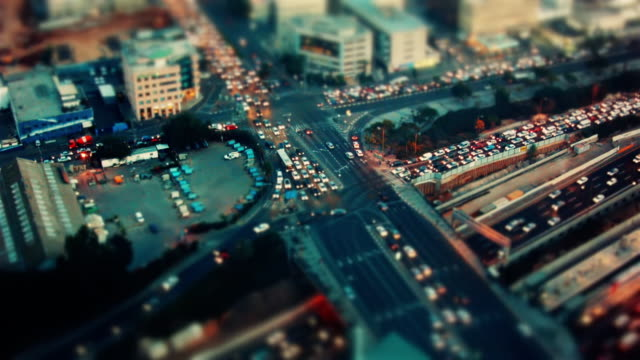 miniature tilt-shift effect  - busy rush hour traffic from dawn to night - spoonfilm stock-videos und b-roll-filmmaterial