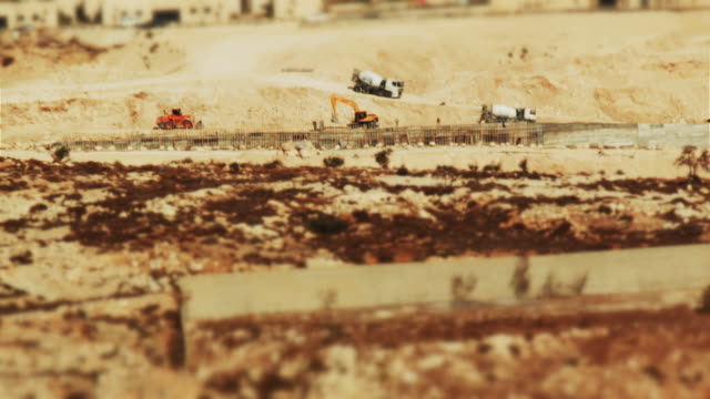miniature tilt-shift effect: construction work of israeli settlement in the west bank - apartheid stock videos and b-roll footage