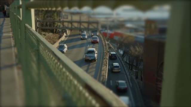 Miniature traffic at sunset with cars and trucks