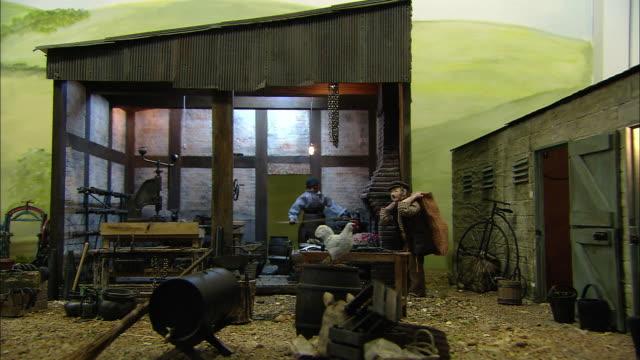 miniaturised late victorian scene, blacksmith, dolls house, leonardslee gardens, west sussex, uk - おもちゃの家点の映像素材/bロール