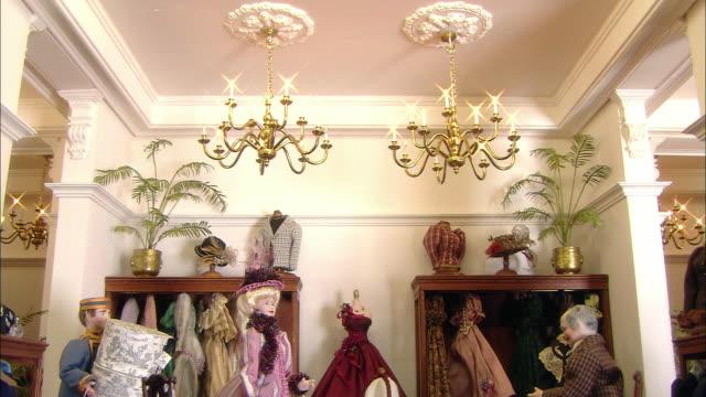 miniaturised late victorian scene, boutique, dolls house, leonardslee gardens, west sussex, uk - stile vittoriano video stock e b–roll
