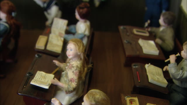 miniaturised late victorian scene, classroom, dolls house, leonardslee gardens, west sussex, uk - おもちゃの家点の映像素材/bロール