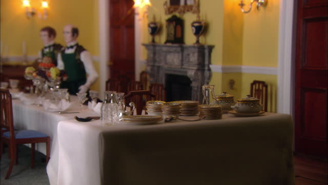 miniaturised late victorian scene, dinner table, dolls house, leonardslee gardens, west sussex, uk - domestic staff stock videos and b-roll footage