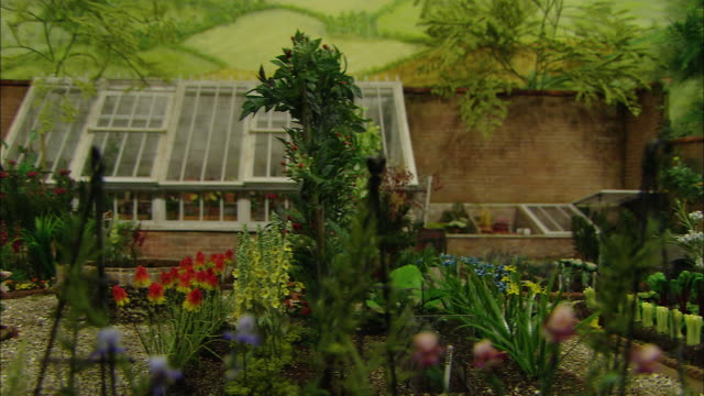 miniaturised late victorian scene, garden, dolls house, leonardslee gardens, west sussex, uk - victorian stock videos & royalty-free footage