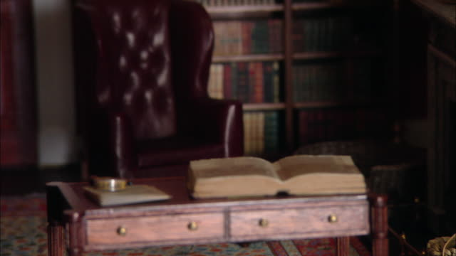 miniaturised late victorian scene, library, dolls house, leonardslee gardens, west sussex, uk - victorian stock videos & royalty-free footage