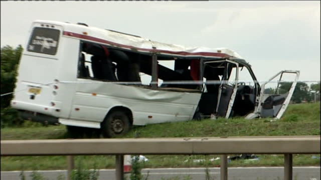 stockvideo's en b-roll-footage met twelve people injured; england: west yorkshire: m1: ext reporter to camera cutways - various of damaged minibus at roadside - high angle views of... - itv weekend evening news