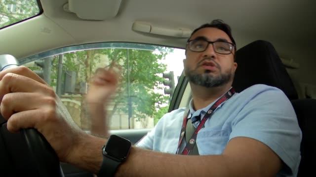 minicab drivers' union begin discrimination case over congestion charge; england: london: ext james farrar interview sot int car abdurzak hadi... - prejudice stock videos & royalty-free footage