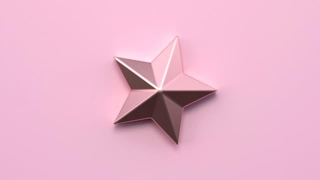 stockvideo's en b-roll-footage met minimale abstracte motion animatie metallic rose gouden vorm 3d rendering roze scène platte lay stervorm kerstvakantie concept - star shape