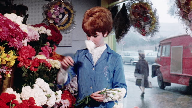 vidéos et rushes de 1970 montage mining apprentice visiting his girlfriend at a flower shop and playing soccer / united kingdom - 1970