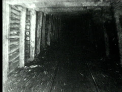 1927 B/W WS POV Mining cart travelling underground in bituminous coal mine tunnel reinforced with timber beams/ Pennsylvania, USA