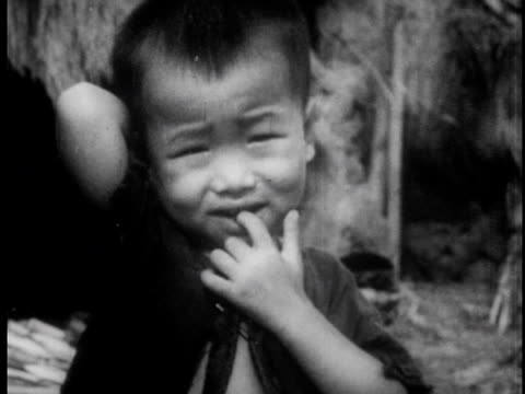 mining coal with shovels in a large coal pit / a textile factory / an impoverished village with hungry children - traditionally vietnamese stock videos & royalty-free footage
