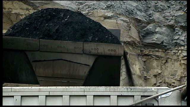 mining companies glencore and xstrata merger announced west virginia ext pile of coal truck tipping load of coal onto back of truck coal along on... - vehicle scoop stock videos and b-roll footage