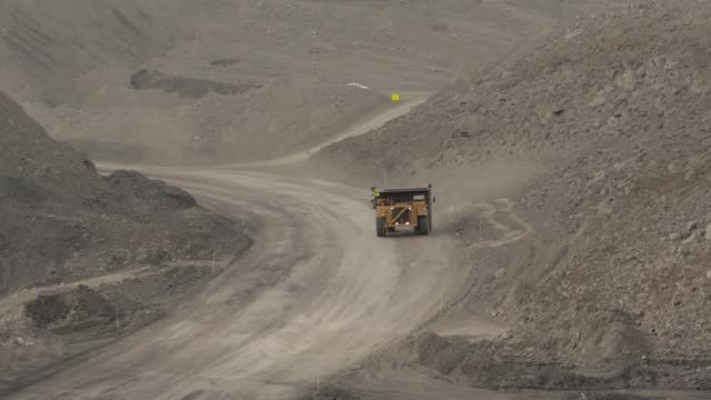 mining dump truck driving - dump truck stock videos and b-roll footage