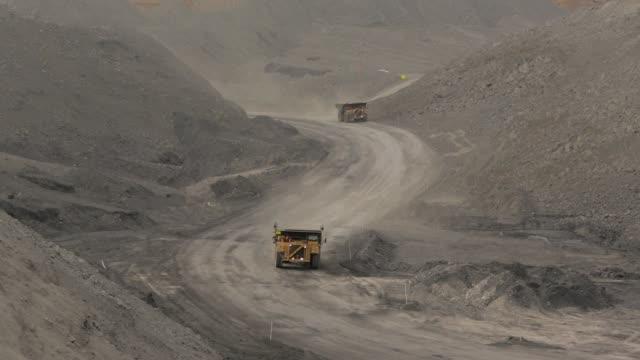 mining dump trucks driving - coal mine stock videos & royalty-free footage