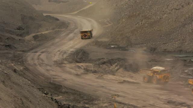 mining trucks at a coal mine - bulldozer stock videos & royalty-free footage