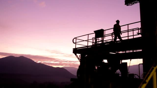 mininig plant at sunset - miner stock videos & royalty-free footage