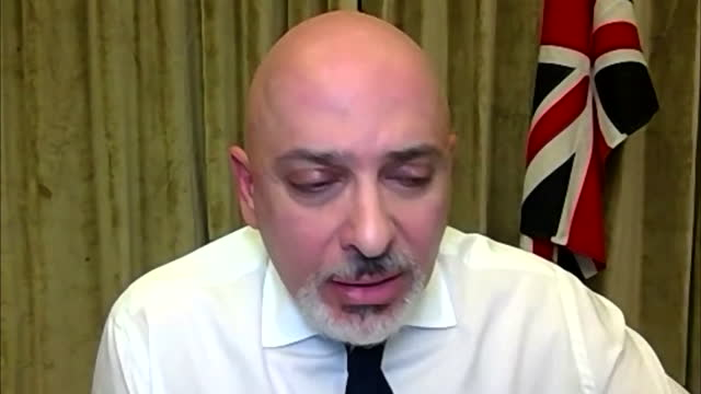 minister for covid vaccine deployment, nadhim zahawi talking about how the government could help in stopping the indian variant breakout in bolton - standing out from the crowd stock videos & royalty-free footage