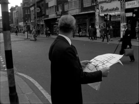 minister for transport surveys new one-way scheme at tottenham court road; england: london: tottenham court road: ext various of ernest marples mp... - tottenham court road stock videos & royalty-free footage