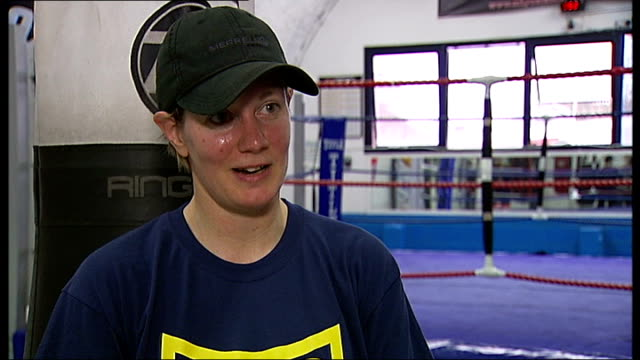minister highlights popularity / women taking up boxing after the olympics; england: london: brixton: int various of leanne spencer boxing in gym... - boxing women's stock videos & royalty-free footage