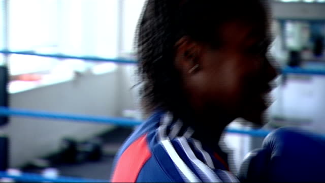 minister highlights popularity / women taking up boxing after the olympics; t04111144 yorkshire: bradford: london 2012 olympic games gold medal... - boxing women's stock videos & royalty-free footage