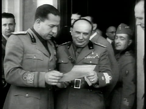 minister of foreign affairs galeazzo ciano w/ benito mussolini talking looking over paper ms mussolini inspecting troops standing at attention in... - anno 1939 video stock e b–roll