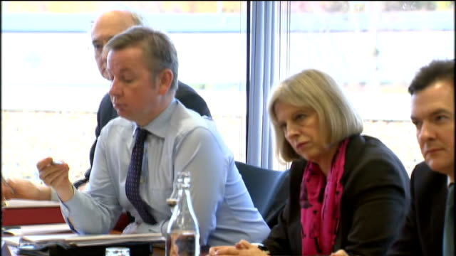 ministers arrive at regional cabinet meeting in ipswich int tracking shot into cabinet meeting / cameron calling meeting to order then explaining why... - cabinet stock videos and b-roll footage