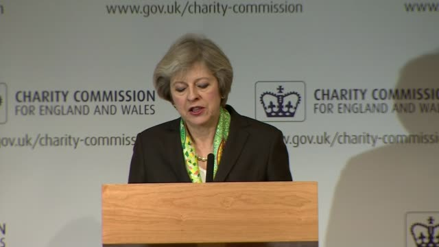 ministers deny nhs 'humanitarian crisis' claims london royal society theresa may mp arriving on stage at charity commission annual meeting wide shot... - mental wellbeing stock videos & royalty-free footage