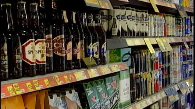 ministers plan price controls to curb binge drinking in scotland rows of bottles and cans of beer and lager on supermarket shelves wine on shelves... - lager stock videos & royalty-free footage