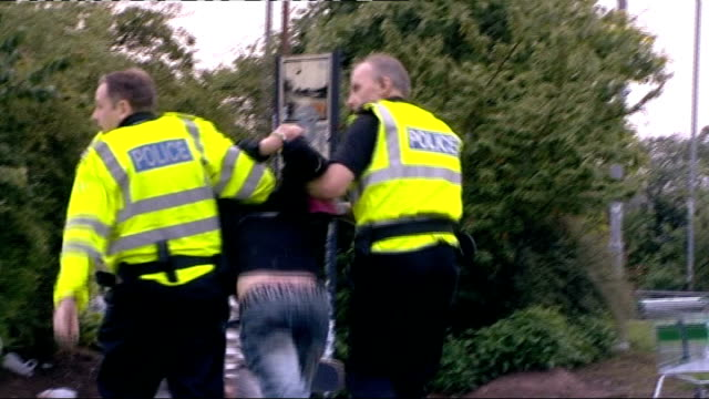 ministers plan price controls to curb binge drinking in scotland; summer 2008 scotland: ext drunk teenage girl escorted away by two police officers... - lager stock videos & royalty-free footage