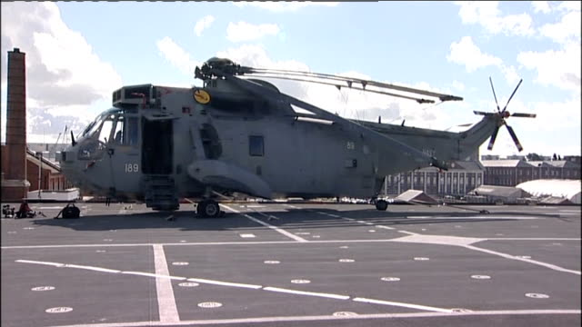 ministry of defence signs contract for two new aircraft carriers hms ark royal and signing ceremony flight deck with helicopters parked / royal navy... - イギリス国防省点の映像素材/bロール
