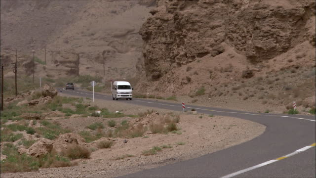 ws zo minivan driving along desert highway, iran - van stock videos & royalty-free footage