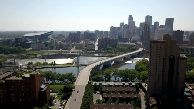 minneapolis skyline along the mississippi river - famous place stock videos & royalty-free footage