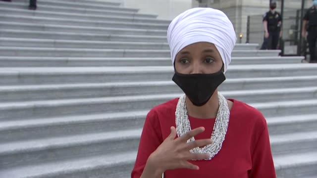 minnesota representative ilhan omar becomes emotionally telling a news producer question outside the capitol building during prolonged votes on a... - executioner stock videos & royalty-free footage