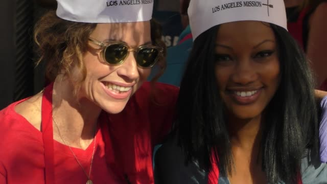 minnie driver and garcelle beauvais volunteer at the los angeles mission thanksgiving meal for the homeless in los angele at celebrity sightings in... - minnie driver stock videos and b-roll footage