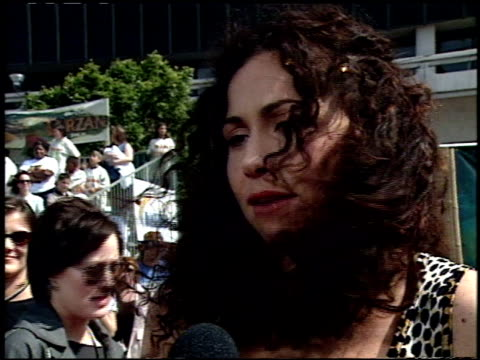 stockvideo's en b-roll-footage met minnie driver at the 'tarzan' premiere at the el capitan theatre in hollywood california on june 12 1999 - 1999