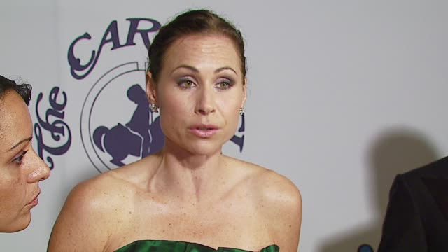 minnie driver on the event at the mercedes-benz presents the 17th carousel of hope ball at the beverly hilton in beverly hills, california on october... - 後ろで束ねた髪点の映像素材/bロール