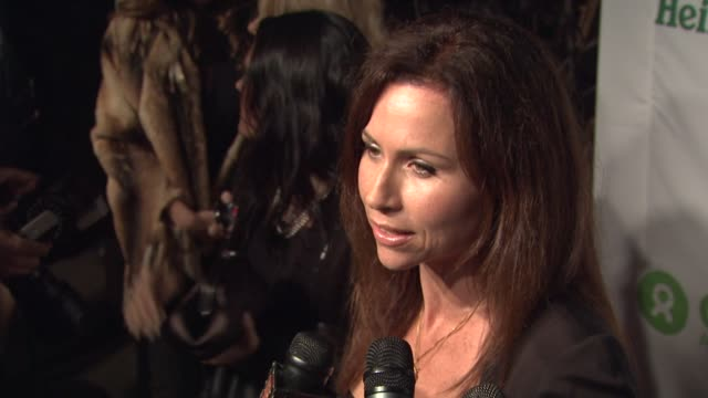 stockvideo's en b-roll-footage met minnie driver on tonight's event and oxfam and on esquire house at the 'the oxfam party' at esquire house la at los angeles ca - minnie driver
