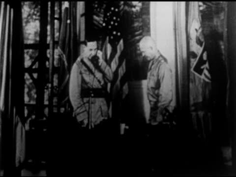 minor basilica of st lorenzo ruiz general douglas macarthur army chief of staff aide lieutenant colonel dwight d eisenhower standing at desk sitting... - douglas macarthur stock videos and b-roll footage