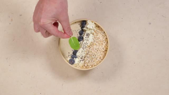 mint leaf garnish on spicy kefir beverage. - garnish stock videos & royalty-free footage