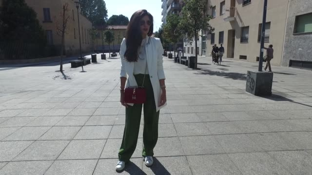 minu pirzadeh wearing hm trousers and blouse zara blazer valentino bag stan smith shoes tom ford glasses and cartier clock is seen during milan... - blouse stock videos and b-roll footage