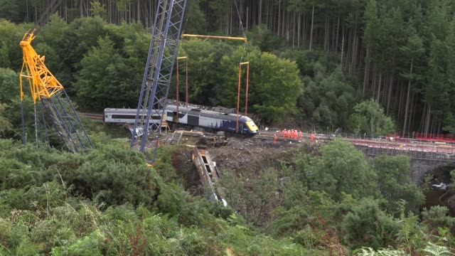 minute's silence has been held ahead of the recovery of the first carriage from the site of the fatal train crash near stonehaven. train driver brett... - crane stock videos & royalty-free footage