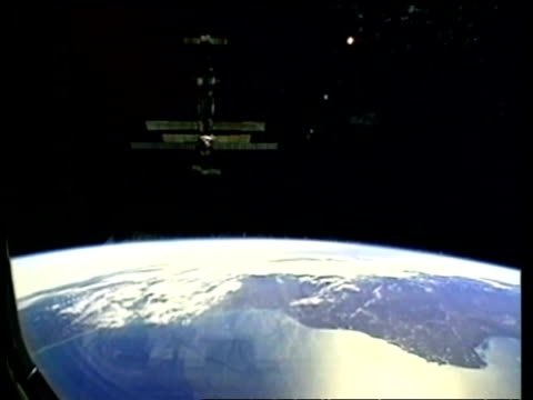 wa mir space station orbiting earth, nasa - mir space station stock videos & royalty-free footage