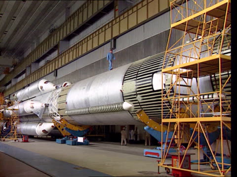 mir space station; russia: moscow space station: int gv giant proton rocket in hangar boosters of rocket pull out tx 11.8.98/nat - atom stock videos & royalty-free footage