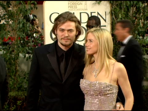 Mira Sorvino and guest at the 2006 Golden Globe Awards Arrivals at the Beverly Hilton in Beverly Hills California on January 16 2006