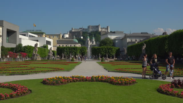 Mirabell Gardens against Salzburg Cathedral and Fortress Hohensalzburg, Salzburg, Austria